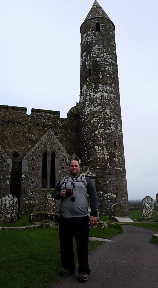 Abe standing with the Rock of Cashel behind him.