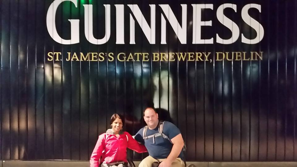 Maggie and Abe posing in front of Guinness Storehouse sign - St. James's Gate Brewery, Dublin