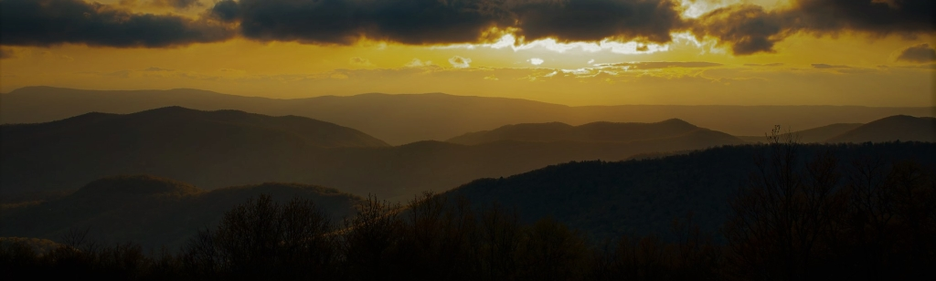 Sunset photo along Skyline Drive with mountains.