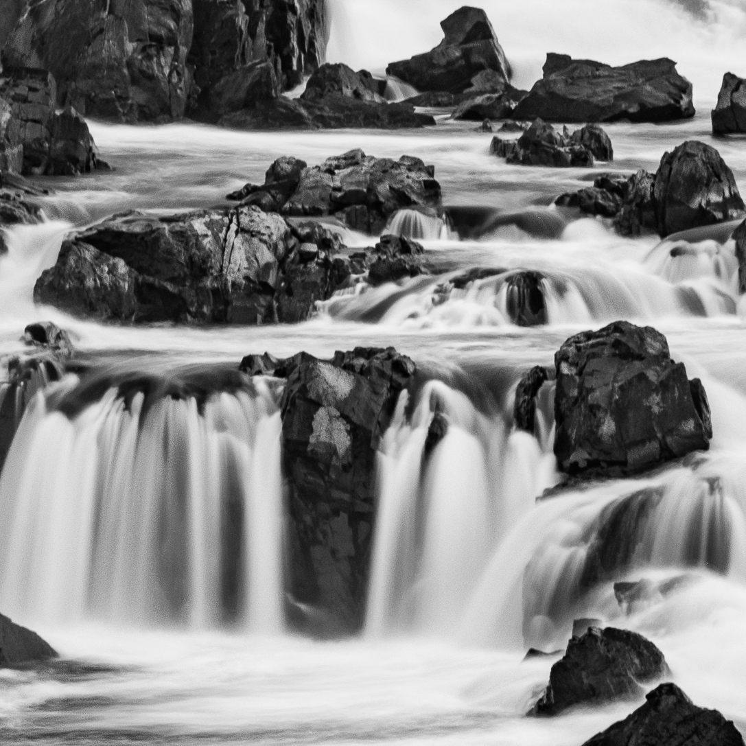 Close up of section of Great Falls waterfalls in black and white.