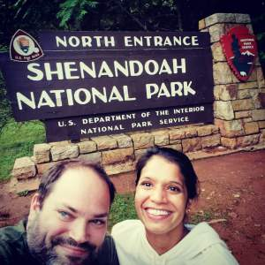 Maggie and Abe in front of Shenandoah National Park North Entrance sign